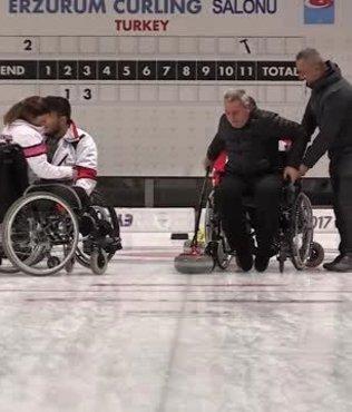 Erzurum Valisi Okay Memiş tekerlekli sandalyede curling oynadı