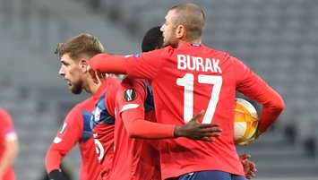 Burak Yilmaz's double sends Lille to knockout stages