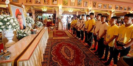 Thai soccer boys pray for fortune